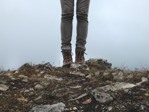girl in boots on rock about therapy and the planet