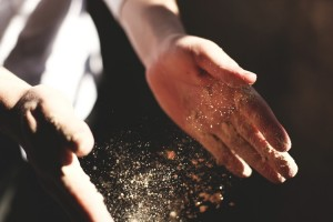 hands letting go of sand for forgivness piece